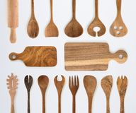 Kitchenware set of wooden fork, spoon and utensils on white back royalty free stock photography