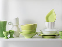 Kitchenware on the shelf. Green kitchenware on the shelf royalty free stock photography