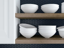 Kitchenware on the shelves. Fragment of interior of modern black and white kitchen. Kitchenware on the wooden shelves Royalty Free Stock Photography