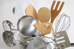Kitchenware. Some stainless and wood utensils background Stock Image