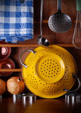 Kitchenware on the table. Kitchenware of metal on the wooden table Royalty Free Stock Photo