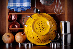 Kitchenware on the table. Kitchenware of metal on the wooden table stock image