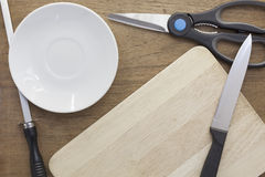 Kitchenware on the wooden background. Royalty Free Stock Photos