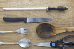 Kitchenware on the wooden background. Stock Images