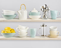 Kitchenware on wooden kitchen shelves Stock Photos