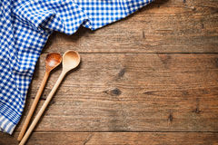 Kitchenware on wooden table Stock Images