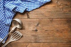 Kitchenware on wooden table stock photo