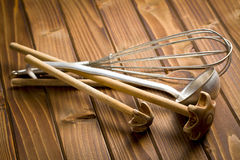 Kitchenware on wooden table Royalty Free Stock Images