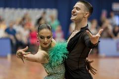 Kitcun Andrey und Krepchuk Yuliya Perform Adult Latin-American Program auf nationaler Meisterschaft lizenzfreies stockbild