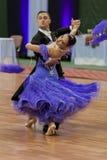 Kitcun Andrey y demostración de la danza de Krepchuk Yuliya Perform Adult Show Case Fotos de archivo libres de regalías