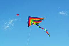 Kite. Colorful kite fly in blue sky Royalty Free Stock Photo