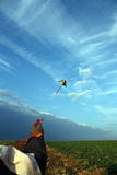 Kite. A hand holding the flying kite Royalty Free Stock Photo