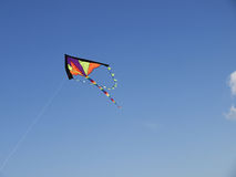 A kite. Against a blue sky Royalty Free Stock Image