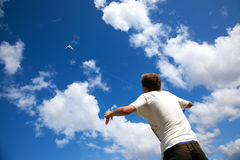 Kite. Boy flying a kite in nice weather Royalty Free Stock Photo