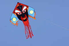 Kite. Beijing opera mask kite in the sky Stock Photos