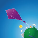 Kite. Flies from planet Earth that says be free Royalty Free Stock Photos