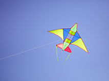 Kite. Flying in the blue sky Stock Photography