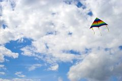 Kite. Colored kite in blue sky at summer day Stock Image