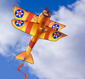 Kite. Bi-plane kite captured on cloudy but sunny day stock photo