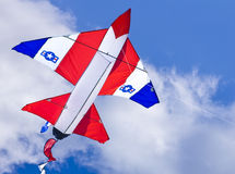 Kite. Jet aircraft kite captured on cloudy but sunny day royalty free stock images