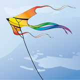 Kite. Multicolor kite in the sky with clouds Stock Photo