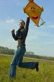 Kite. Man flying a yellow kite in autumn stock photography