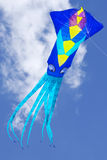 Kite. Large squid kite captured on a partly cloudy day stock photography