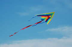 Kite. Colorful kite ascending over blue sky Royalty Free Stock Image