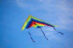 Kite. Multi-colored kite on blue sky Royalty Free Stock Image
