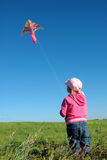 Kite Against The Sky. Girl Keeps Rope. Stock Photography