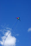 Kite in air. Colorful kite flying high in strong wind stock photography