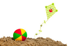 Kite and balll at the beach Stock Photography