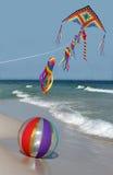 Kite and Beach Ball on Florida Beach. A beach ball and a flying kite on a sunny Florida beach stock photos
