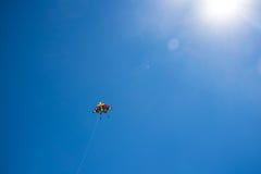 Kite in blu sky. Kite in blu sky with sun stock photos