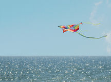 Kite blue sky. Children's toy. Kite flying in the sky over the sea Royalty Free Stock Image
