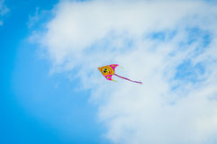 Kite In The Blue Sky With Fluffy Clouds Royalty Free Stock Photo
