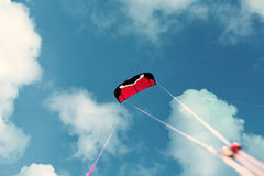 Kite in the blue sky. Winter riding a kite Royalty Free Stock Images