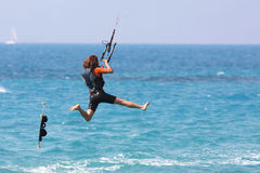 Kite boarder. Flying through the air on a sunny day Royalty Free Stock Images