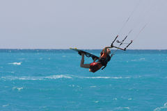 Kite boarder. Flying through the air on a sunny day Stock Photography
