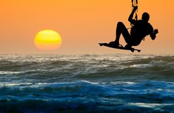 Kite boarder in action. And sunset royalty free stock images