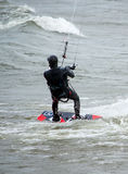Kite boarder braces for a big wave Royalty Free Stock Images