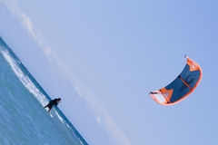 Kite boarder enjoy surfing. In the sea Stock Photos