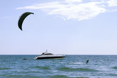 Kite boarder enjoy surfing. In the sea Stock Images