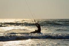 Kiteboarder enjoy surfing in the sea. Kite boarder enjoy surfing in the sea at dusk Stock Photo