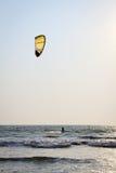 Kiteboarder enjoy surfing in the sea. Kite boarder enjoy surfing in the sea at sunny day Stock Images