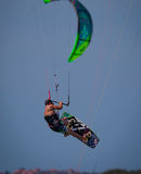 Kite Boarder in Florida flies dramatically through the sky. High above the ocean Royalty Free Stock Photo