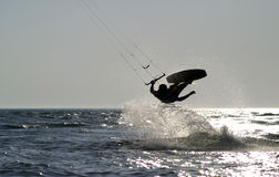 Kite boarder jumping on the ocean. Late afternoon stock photo