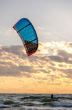 Kite boarder at sunset Stock Photo