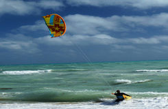 Kite Boarder Surfs Beach Stock Image