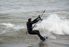 Kite boarder touching down Royalty Free Stock Image